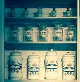 Бутылки в старой фармации Стоковое фото RF