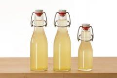 3 бутылки заполненной с сиропом elderflower Стоковая Фотография RF