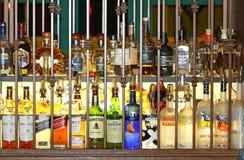 Бутылки ликера за решеткой Стоковые Фотографии RF