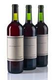 Бутылки красного вина изолированные на белизне Стоковая Фотография RF
