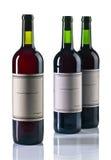 Бутылки красного вина на белизне Стоковое Изображение