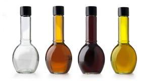Бутылки оливкового масла и уксуса. Стоковые Фото