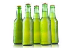 Бутылки пива на белой предпосылке Стоковое Изображение