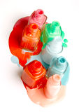 Бутылки политуры ногтей на белой предпосылке Стоковые Изображения