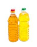 2 бутылки подсолнечного масла на светлой предпосылке Стоковое Фото