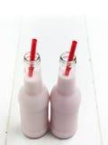 2 бутылки розового молока с соломами Стоковая Фотография RF