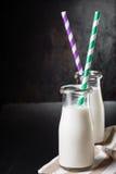 2 бутылки с молоком Стоковая Фотография RF