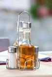Бутылки с оливковым маслом, уксусом, солью Стоковые Фотографии RF