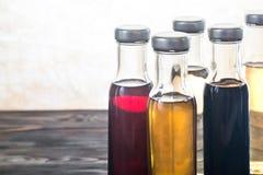 Бутылки с различными видами уксуса Стоковые Фото