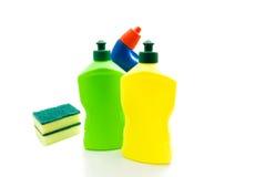 Бутылки тензида и губок на белизне Стоковое фото RF