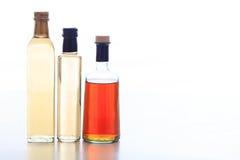 Бутылки уксуса на белой предпосылке Стоковое Изображение RF