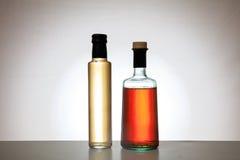 Бутылки уксуса на предпосылке градиента Стоковое Изображение RF