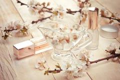 2 бутылки дух окруженной цветением абрикоса Стоковые Фото
