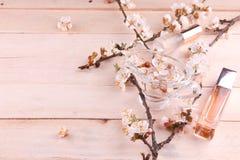 2 бутылки дух окруженной цветением абрикоса Стоковое Изображение RF