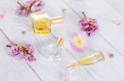 Бутылки дух с цветками Стоковая Фотография RF