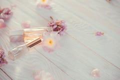 Бутылки дух с цветками Стоковая Фотография