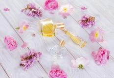 Бутылки дух с цветками Стоковые Изображения RF