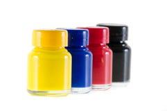 Бутылки чернил в цветах cmyk Стоковое Изображение RF