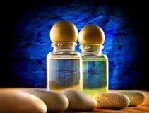 Бутылки шампуня с камнями Стоковые Фото
