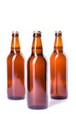 3 бутылки льда - холодного пива изолированного на белизне Стоковые Фото