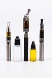 3 бутылки E-сигарет Vape 3 сока vape и Стоковое Фото