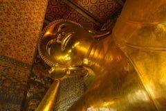 Будда, большой золотой возлежа Будда Wat Phra Chetuphon по месту известное как Wat Pho Стоковая Фотография RF