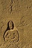 Будда высек в кирпиче Стоковое Изображение