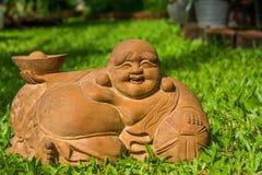 Будда на траве Стоковая Фотография