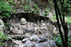 Буддийское резное изображение в пещерах Feilai Feng Стоковые Фото