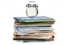 Будильник и документы 2 Стоковые Фото