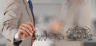 Будущее семьи планирования выставки руки бизнесмена Стоковые Фотографии RF