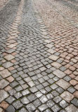 Булыжник, каменная текстура мостоваой в старом городе стоковая фотография