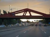 Бульвар генерала Paz в столице Буэноса-Айрес на заходе солнца Стоковые Фотографии RF