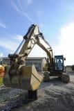 Бульдозер экскаватора на строительной площадке Стоковые Изображения RF
