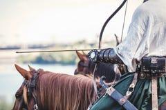Бывший всадник держа лук и стрелы Стоковое Изображение