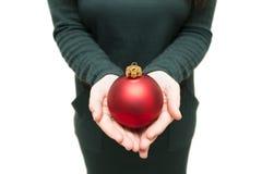 Бык рождества в девушке руки Стоковые Фотографии RF
