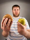 быстро-приготовленное питание здоровое против Стоковые Изображения