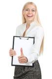 бюллетень доски держит большой пец руки вверх по женщине Стоковая Фотография