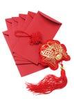 Благоприятный орнамент рыб и красные пакеты Стоковое Фото