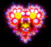 Блески и sparkles в форме романтичного красного цвета Стоковая Фотография