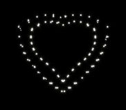 Блески и sparkles в форме 2 романтичного Стоковые Изображения RF
