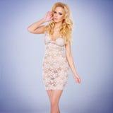 Блестящее молодое белокурое в a видеть-через платье стоковая фотография rf
