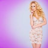 Блестящее молодое белокурое в a видеть-через платье Стоковая Фотография