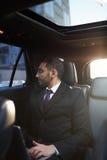 Ближневосточный бизнесмен в дорогом автомобиле Стоковое Фото