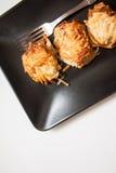 Блинчики картошки на белизне Стоковые Изображения