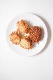 Блинчики картошки на белизне Стоковое Фото