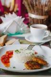 Блинчики картошки с рисом и томатным соусом Стоковые Фото