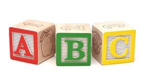 блоки предпосылки алфавита изолировали белизну стоковые изображения rf