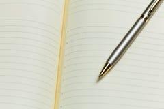 Блокнот и ручка Стоковое Изображение RF