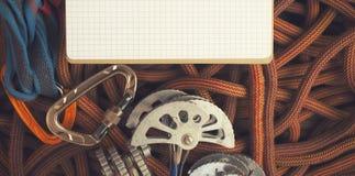 Блокнот и шестерня для вашего приключения Стоковые Фото